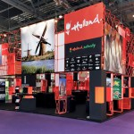 Photograph of Holland's 2010 stand (orange & black) at WTM Exhibition