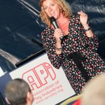 Photograph of Sally Gunnel speaking at the API conference as part of PlayFair Exhibition