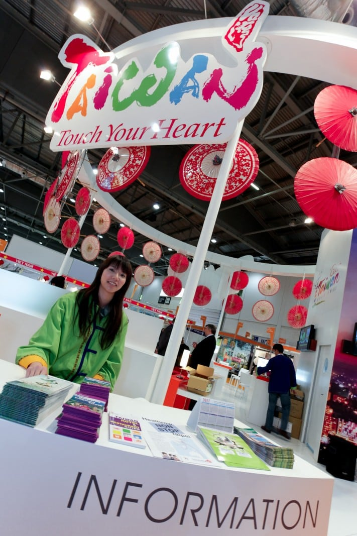 Photograph of promo-girl in traditional dress at Taiwan's stand, WTM, London