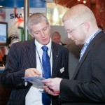 Photograph of exhibitor and delagate networking at a conference in London