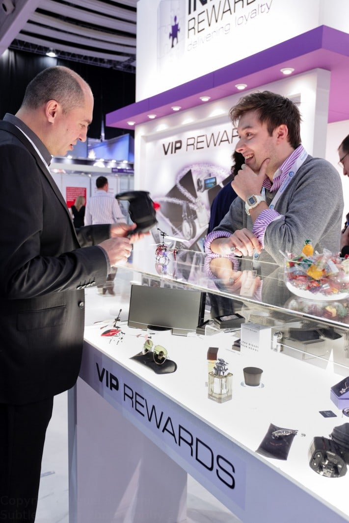 Photograph of exhibitor discussing a product with visitor to ICE