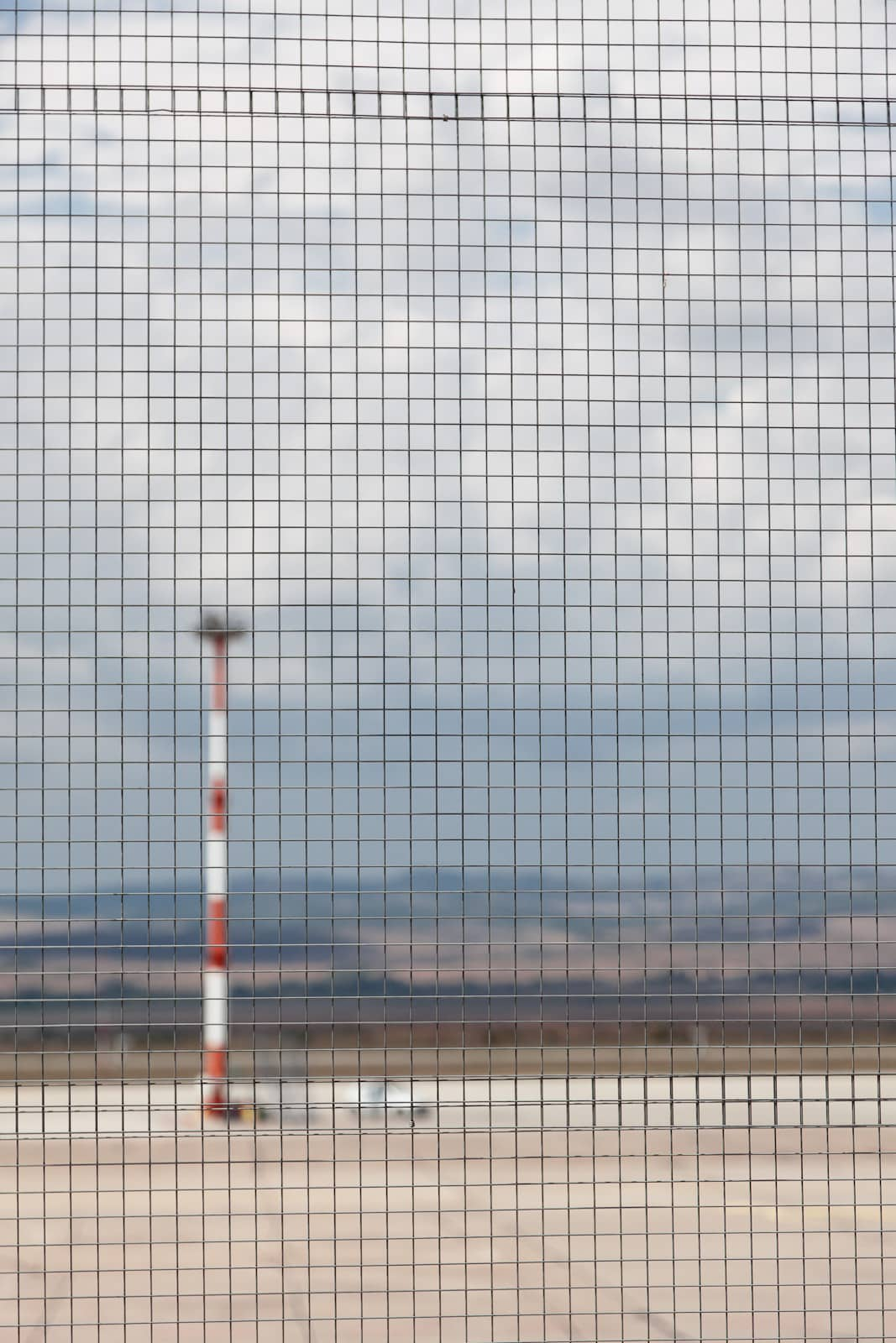 photo of airport apron through wire mesh fence