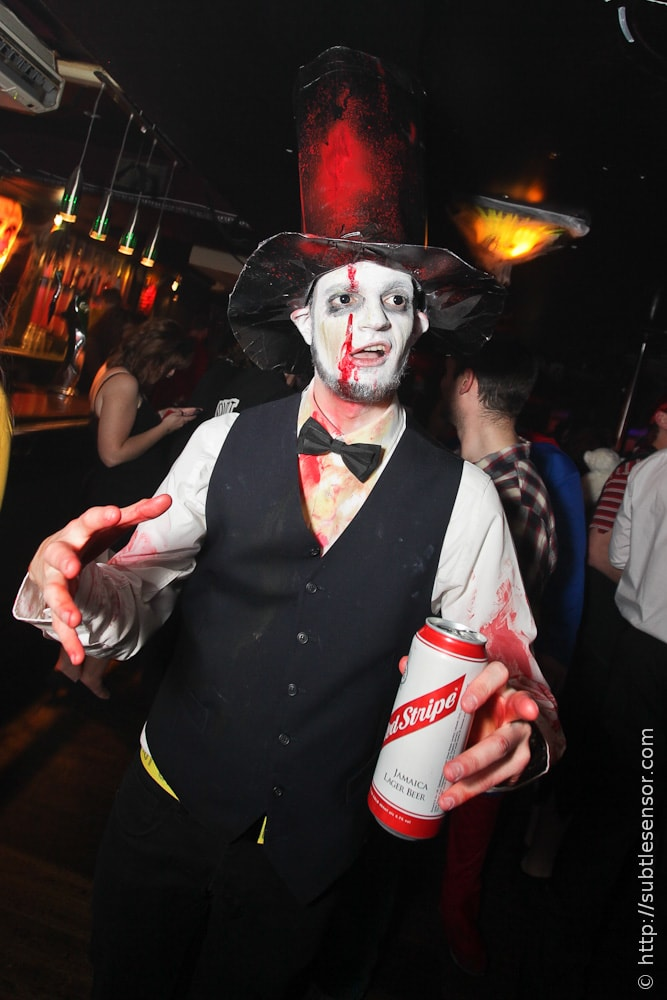 Zombie Abraham Lincoln drinking Red Stripe at Halloween
