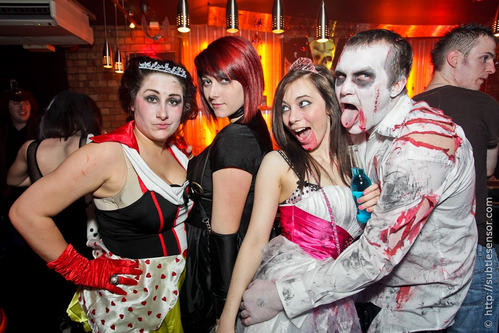 Group of people in scary halloween costumes