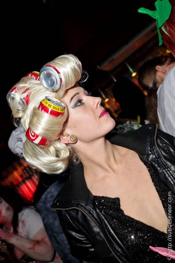 Halloween costume - girl with Coca-Cola cans in hair