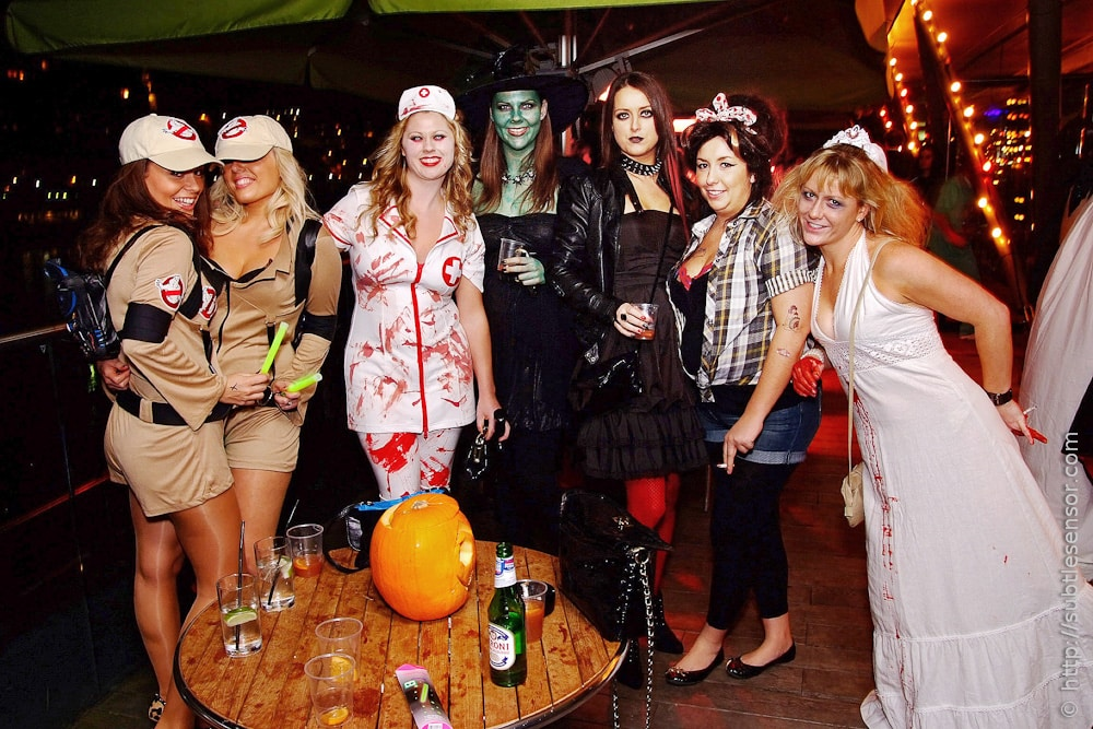 Mixed group of halloween partygoers