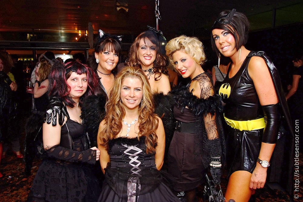 Group of girls in black, sexy witch halloween costumes