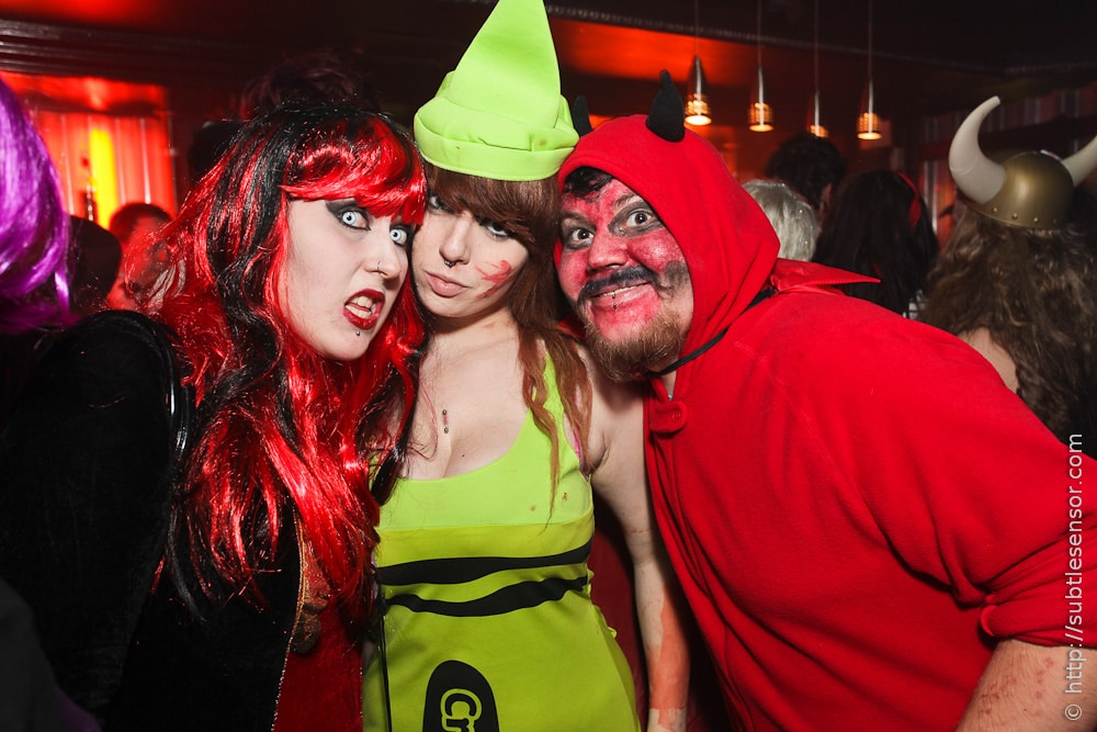Devil, crayon, witch - people in halloween costumes
