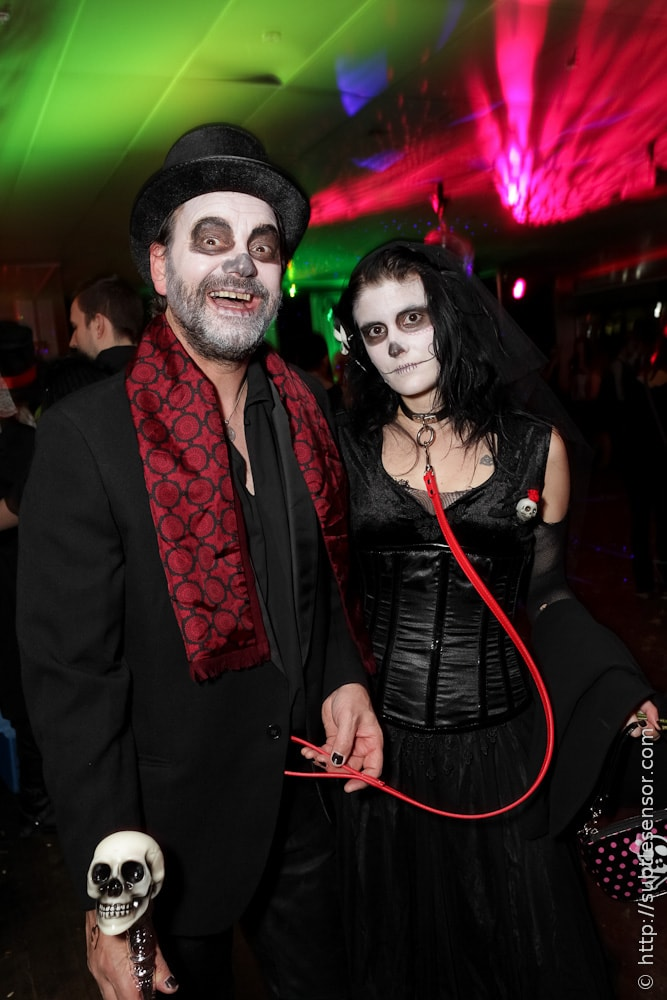 Couple in Halloween Makeup and Costumes