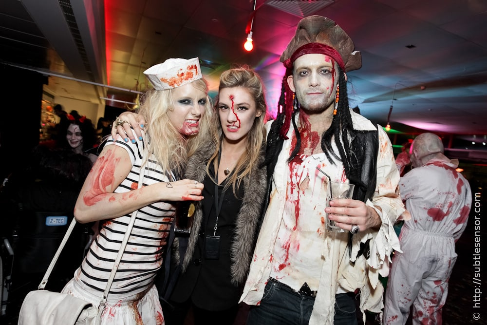 Attractive people in Halloween makeup & fancy dress costumes