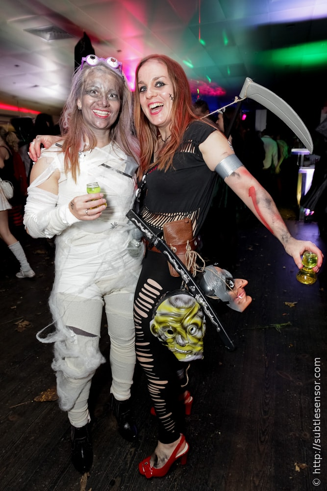 Girls in Halloween costumes - Mummy & Head Hunter