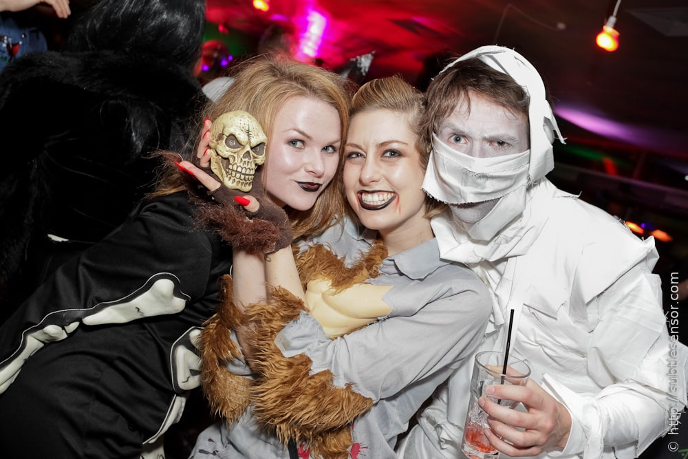 Mixed group of halloween partygoers in costume and makeup