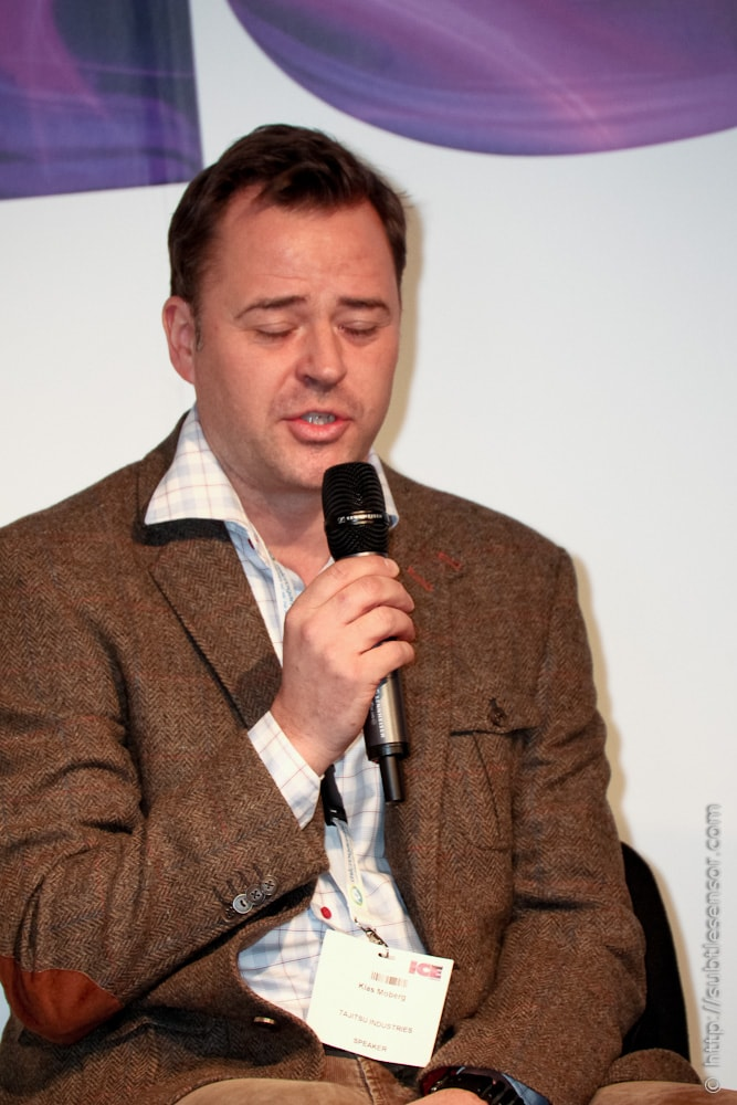 Picture of speaker blinkng during a panel session at ICE 2012